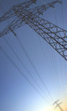 Power line. Electric power lines on blue sky stock photos