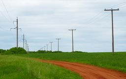 Power line. On the field Royalty Free Stock Photo