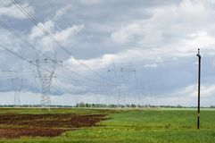 Power line. Сable carrying electrical power, especially one supported by pylons or poles. Power line Stock Images