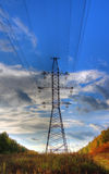 Power line against a beautiful sky Royalty Free Stock Photography