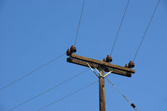 Power line against blue sky Royalty Free Stock Photo