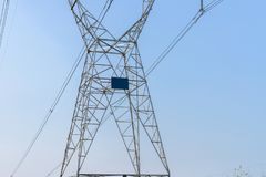 Power line against blue sky background Stock Images