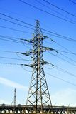 Power transmission tower with road royalty free stock image