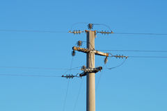 Power line against the blue sky Stock Images