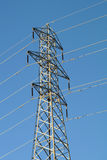 Power line against the blue sky Stock Image