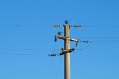 Power line against the blue sky Stock Photography