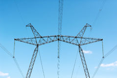 Power line against the blue sky. Transfer of the electric power Stock Photo