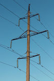 Power line against bright sky Royalty Free Stock Photo