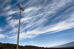 Power line against vibrant sky on the volcano. Stock Images