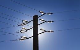 Power line. Back light silhouette of power line against blue sky. Alternatives energies concept Stock Images