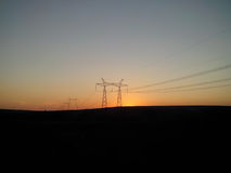 Power line. On background of beautiful sunset Royalty Free Stock Image