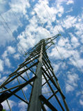 Power line in the blue sky. Power line in the blue cloudy sky (flying tower royalty free stock images