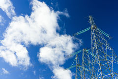 Power Line On Blue Sky With Clouds Royalty Free Stock Image