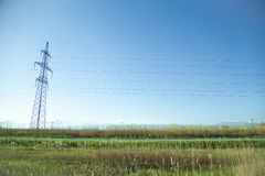 Power line at the blue sky. High voltage towers stock photo