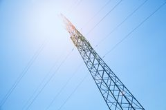 Power line at the blue sky. High voltage towers royalty free stock photos