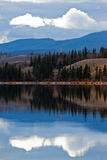 Power Line at Calm Yukon Lake in Late Fall, Canada Royalty Free Stock Image