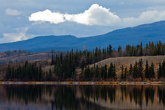 Power Line at Calm Yukon Lake in Late Fall, Canada Royalty Free Stock Images