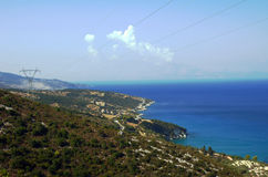 Power line on coast at Zakynthos island Royalty Free Stock Photo