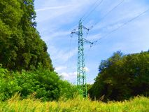 Power line column on meadow Stock Photos