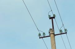Power line on a concrete column Royalty Free Stock Photo