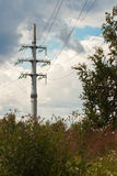 Power line consists of conductors suspended by towers or poles. Stock Photography