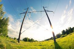 Power line in a contryside. Shooted with fisheye lens Royalty Free Stock Photography
