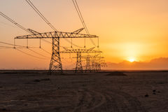 Power line in desert Royalty Free Stock Images
