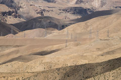 Power line on dessert valley Stock Image