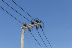 A power line on electricity post Royalty Free Stock Photos
