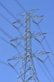 Power line and electricity pylon Stock Photos