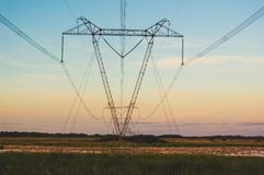Power line in a field on the background of beautiful sunset.  stock images