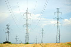 Power line. In a field of wheat Royalty Free Stock Photo