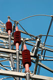 Power Line Fixtures. Three red ceramic high-voltage power line fixtures for grounding of the cables Stock Images