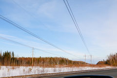 Power line, forest and road in a spring day Stock Images