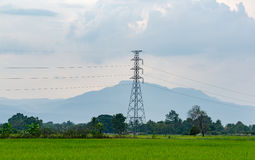 Power Line. In the Green Field in front of the Hill Stock Photos