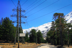 Power line high in the mountains. Stock Image