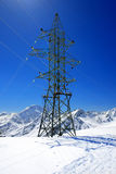 Power line high in the mountains. Stock Photos