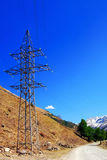 Power line high in the mountains. Stock Images