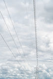 Power line high voltage on cloud and blue sky Stock Photo