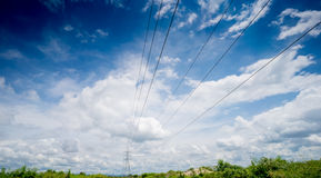 Power line high voltage on cloud and blue sky Stock Photos