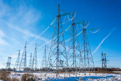 The power line. High voltage transmission line on the background of blue sky stock image