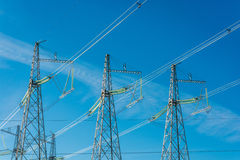 The power line. High voltage transmission line on the background of blue sky royalty free stock photos