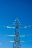 The power line. High voltage transmission line on the background of blue sky Stock Photos