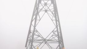 Power line mast in the fog