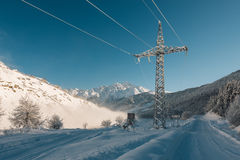 Power line in the mountain road Stock Image