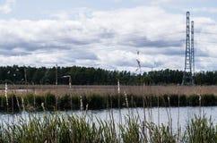 Power line near the lake stock photo