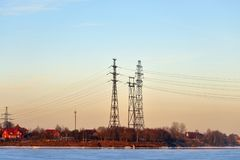 Power line and Neva River. Power line and Neva River at winter evening on the outskirts of St. Petersburg, Russia Royalty Free Stock Photography