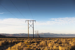 Power line and open field Royalty Free Stock Images