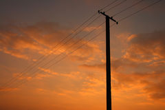 Power Line on orange sky. Power Line tower isolated on orange sky Royalty Free Stock Images