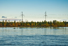 Power line over the forest Stock Images